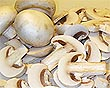 cogumelos frescos cortados